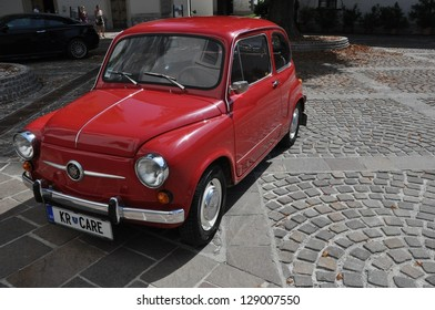 RADOVLJICA, SLOVENIA - AUGUST 26: The red Zastava 750 (almost known as Fico) on August 26, 2012 in Radolvjica, Slovenia. It is a version of the Fiat 600 made under licence from 1965.