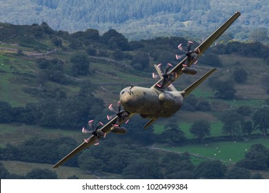 An RAF C130J Hercules flies low level through the Mach Loop, Snowdonia