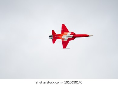 RAF FAIRFORD, GLOUCESTERSHIRE, UK JULY 2017: A pilot from the Patrouille Suisse Display Team banking left in the skies of Gloucestershire, UK