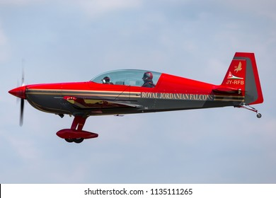 RAF Fairford, Gloucestershire, UK - July 9, 2014: Royal Jordanian Falcons aerobatic team Extra EA-300L JY-RFB on approach to land.