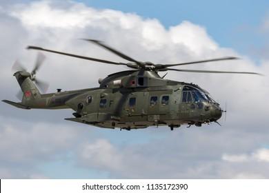 RAF Fairford, Gloucestershire, UK - July 14, 2014: Royal Air Force (RAF) AgustaWestland Merlin HC3 (EH-101) ZJ122 medium lift utility helicopter.
