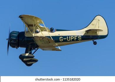 RAF Fairford, Gloucestershire, UK - July 10, 2014: Vintage Waco UPF-7 biplane G-UPFS.