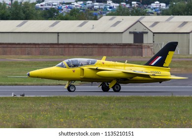 RAF Fairford, Gloucestershire, UK - July 11, 2014: Former Royal Air Force (RAF) 1950s era Folland Gnat T Mk.1 jet trainer aircraft G-MOUR.
