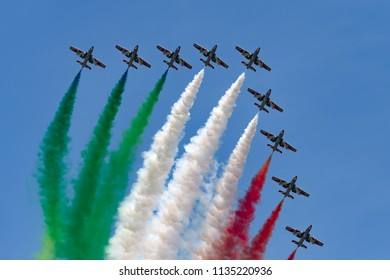 RAF Fairford, Gloucestershire, UK - July 12, 2014: Frecce Tricolori formation display team of the Italian Air Force (Aeronautica Militare Italiana) flying Aermacchi MB-339PAN aircraft.