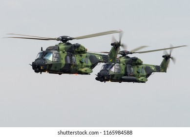 RAF FAIRFORD, GLOUCESTERSHIRE, UK - JULY 16: Two NHIndustries NH90 military transport helicopters of the Finnish Air Force on July 16, 2018 at RAF Fairford, Gloucestershire, UK.