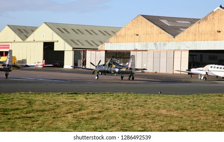 RAF pilot climbing out of the cockpit of his aircraft at Blackpool Airport, Blackpool, Lancashire, England, Europe on Monday, 14th, January, 2019