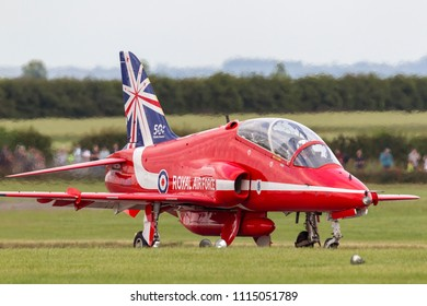 RAF Waddington, Lincolnshire, UK - July 6, 2014: Royal Air Force (RAF) Hawker Siddeley Hawk T.1A XX219 of the Royal Air Force Aerobatic display team the Red Arrows at the RAF Waddington Airshow.