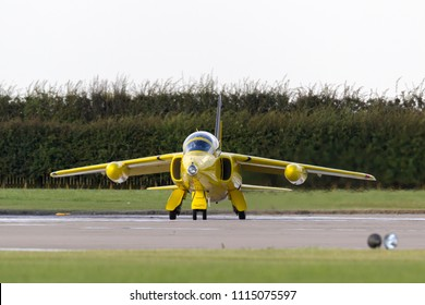 RAF Waddington, Lincolnshire, UK - July 7, 2014: Former Royal Air Force (RAF) 1950s era Folland Gnat T Mk.1 jet trainer aircraft G-MOUR in the distinctive yellow of the Yellowjacks display team.