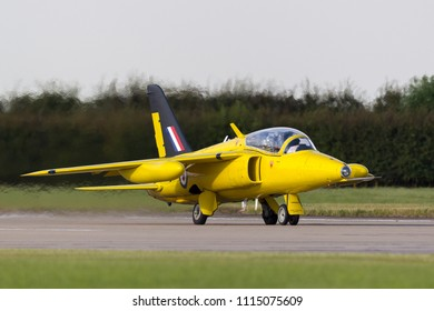 RAF Waddington, Lincolnshire, UK - July 7, 2014: Former Royal Air Force (RAF) Folland Gnat T Mk.1 jet trainer aircraft G-MOUR in the distinctive yellow of the Yellowjacks aerobatic display team.