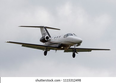 RAF Waddington, Lincolnshire, UK - July 4, 2014: Cessna 510 Citation Mustang light business jet airplane G-RNER on approach to land.