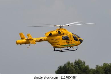 RAF Waddington, Lincolnshire, UK - July 7, 2014: Lincolnshire & Nottinghamshire Air Ambulance McDonnell Douglas MD902 Explorer rescue helicopter G-LNCT.
