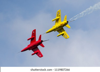 RAF Waddington, Lincolnshire, UK - July 7, 2014: Former Royal Air Force (RAF) Red Arrows aerobatic display team 1950s era Folland Gnat T Mk.1 jet trainer aircraft G-TIMM.