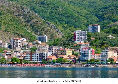RAFAILOVICI, MONTENEGRO - SEPTEMBER 19, 2015: View from sea to popular resort village of Rafailovici (Hotel Obala Plus 3*, Apartment Lux Tri Ribara 4*, fish restaurant Tri Ribara), Montenegro
