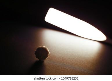 Raffaello. Ball Of Rafaello Lie On A Black Background. The Lamp Shines On  Food