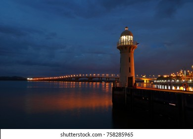 Raffles Marina Lighthouse, situated at the west end of Singapore Island, marks the entrance to the Strait of Johor