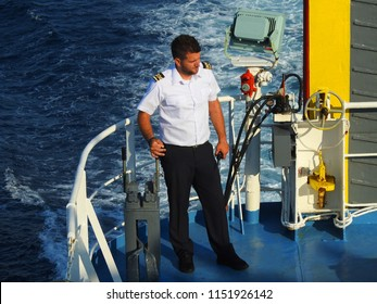 Rafina, Attica /Greece - July 15 2018: Photo of Naval Officer operating Golden Star Ferries passenger ship leaving port of Rafina