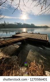 Raft on Medno lake on Sava riveron  a winter morning, Slovenija
