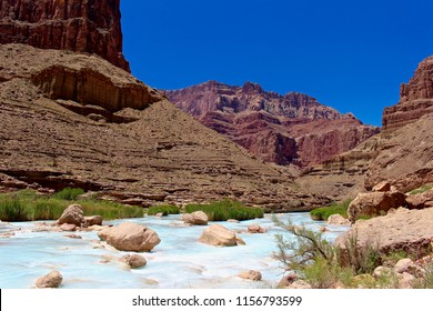 Raft Trip View From the Bottom of the Grand Canyon Looking Up at the Cliffs Above the blue water of the Little Colorado River