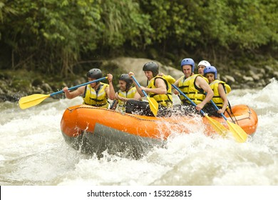 raft water white group activity outdoor river recreation sport ecuador gathering of mixed tourist men and women with guided by specialist pilot on whitewater flow rafting in ecuador raft water white g