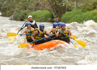 raft water white river sport adventure rowing whitewater group team community of mixed mountaineer male and women with guided by professional pilot on whitewater river rafting in ecuador raft water wh