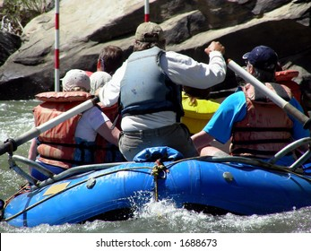 Rafter navigating down a mountain river though slalom gates