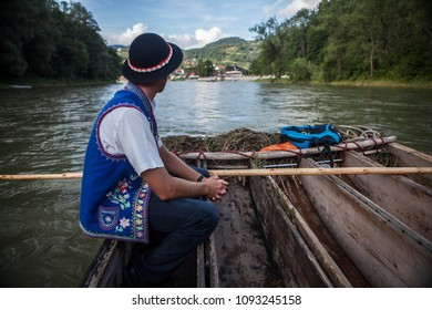 Rafter in a wooden boat, Pieniny National Park in Poland