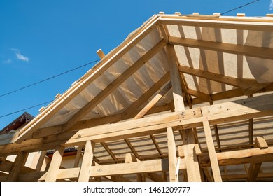rafters and beams in the construction of the roof frame