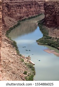 Rafters make their way down the Colorado River at Lee's Ferry, Arizona