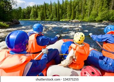 Rafters in a rafting boat on Pistojoki river in Karelia, Russia