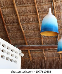 A rafters under a palm leaves roof.