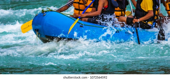 Rafting. Close-up view of oars with splashing water in Rishikesh India