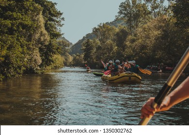 Rafting on the river Cetina between woods in Croatia