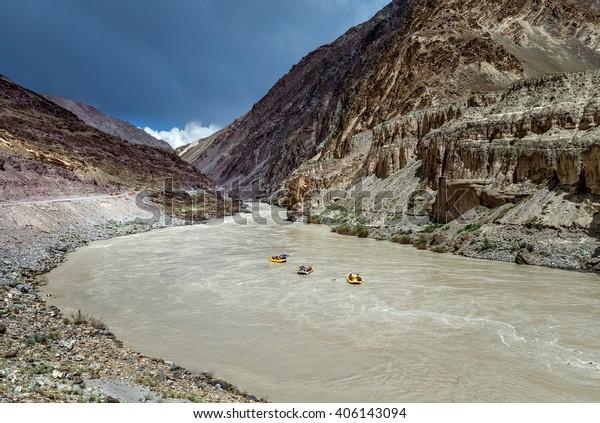 Rafting on the Zanskar river near the confluence of the Indus and Zanskar river - Tibet, Leh district, Western Ladakh, Himalayas, Jammu and Kashmir, Northern India.