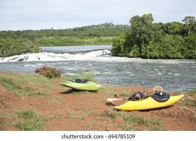 Rafting in Uganda, Africa, river Nile, waterfalls, nature, turism. Yellow and green kayaks.