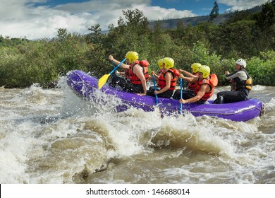 rafting water white river team adventure sports rapids competition men partnership of mixed mountaineer men and femininity with guided by professional pilot on whitewater river rafting in ecuador raft