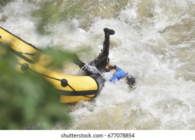 Rafting in the white water, falling off the boat