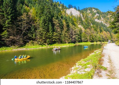 Rafts with tourist on Dunajec river in autumn landscape of Pieniny Mountains, Poland