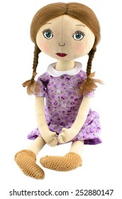 Rag doll girl dressed in pink