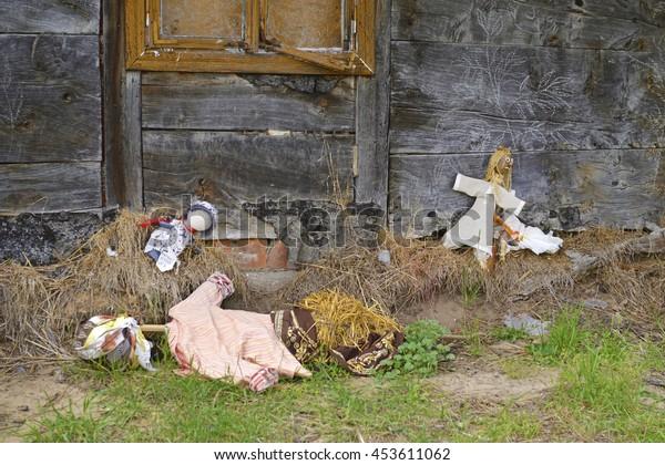 Rag dolls abandoned in the garden.