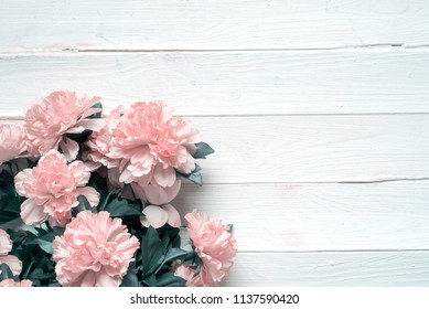 rag flowers. Wooden background with copy space