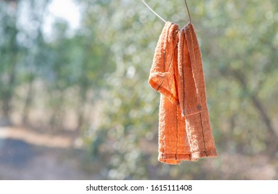 The rag was washed and hung on a hanger.