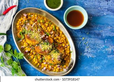 Ragda Pattice / Indian street food Alu Tikki Chat made of potato Patties white beans serve with tamarind cilantro chutney