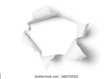 Ragged hole torn in ripped paper, isolated on white background