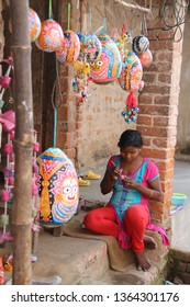 Raghurajpur, India – February 24, 2019: Portrait of a young girl who is painting colored eggs
