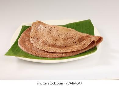 Ragi dosa on white plate