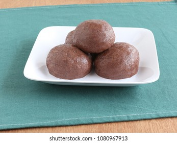 Ragi or finger millet balls, which are a healthy southern Indian food, in a tray.