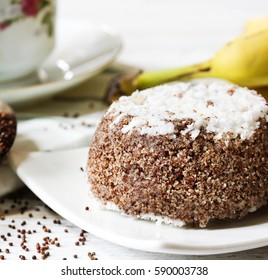 Ragi Puttu  - South Indian breakfast with Finger Millet and fresh coconut served with banana, selective focus