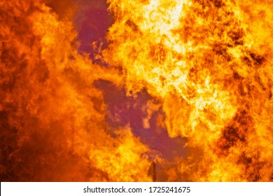 Raging flames of huge fire. Firestorm close up. Burning fire full frame image. Bright inferno flames. Hell fire explosion. Blaze fire texture. Burning bright Bonfire. Intense combustion and heat.