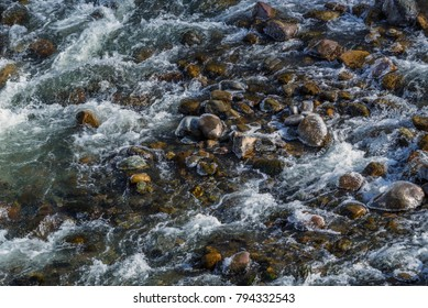 Raging water in threshold of the mountain river