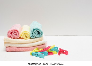 Rags, towels and clothespin on white background.